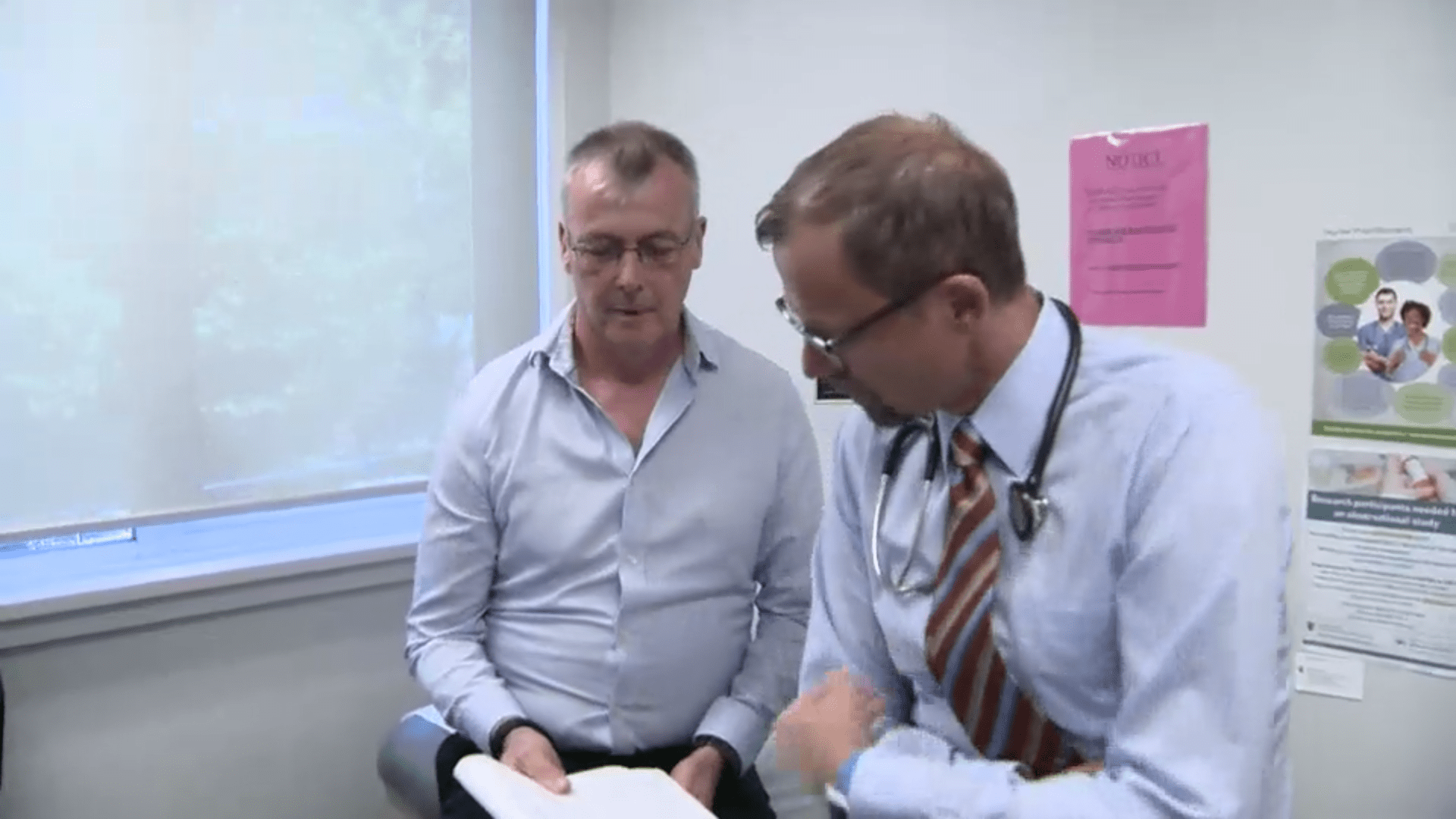 A man meeting with his doctor in a medical office